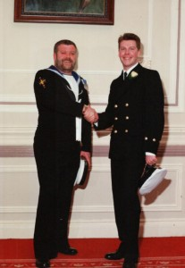 Geoff Oakey shaking hands with his brother Chief Petty Officer Stuart Oakey (Stuart is 10 years younger than Geoff)